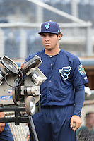 Alex Jackson (10) of the Everett AquaSox uses the pitching machine before a game against the Spokane Indians at Everett Memorial Stadium on July 25, 2015 in Everett, Washington. Spokane defeated Everett, 10-1. (Larry Goren/Four Seam Images)