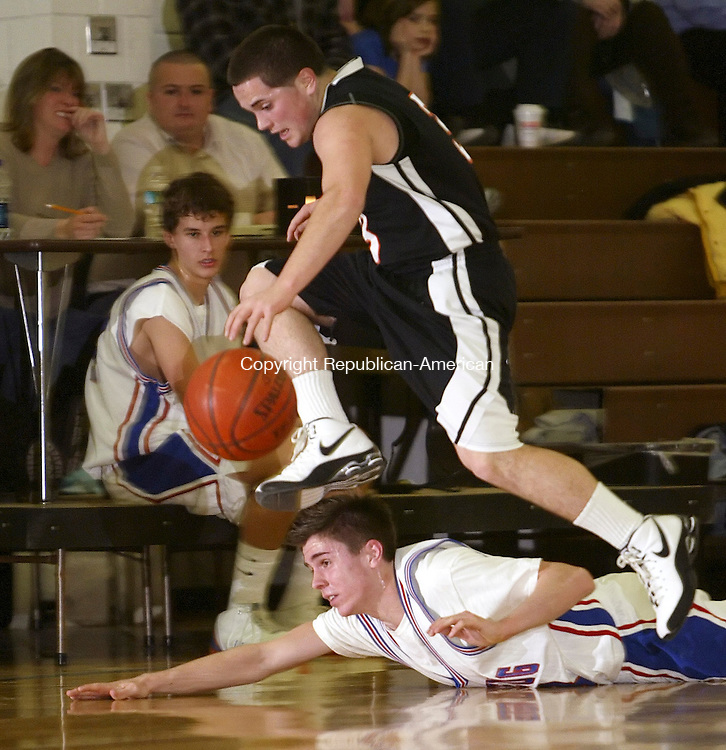 WOODBURY, CT, 02/05/08- 020509BZ07- Terryville's Asim Memeti (3) jumps Nonnewaug's Connor Boyen (33) while chasing the loose ball Thursday night.<br /> Jamison C. Bazinet Republican-American