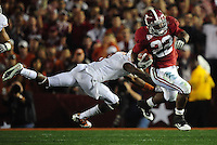 Jan 7, 2010; Pasadena, CA, USA; Alabama Crimson running back Mark Ingram (22) runs with the ball and breaks a tackle by Texas Longhorns cornerback Chykie Brown (8) during the second quarter of the 2010 BCS national championship game at the Rose Bowl.  Mandatory Credit: Mark J. Rebilas-...