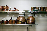 Copper pots, pans and saucepans sit on shelves in a in a storage room kitchen at the Gregoire Ferrandi cooking school in Paris, France, 17 December 2007.