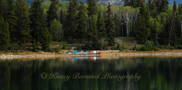 Kayak and row boats line the placid shore of Patricia Lake Jasper National Park.