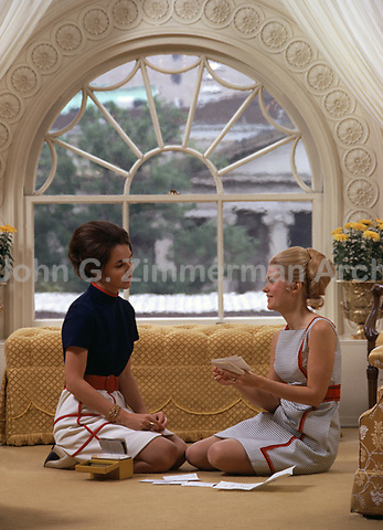 Trisha Nixon plans her wedding with sister Julie Nixon Eisenhower, the White House, Washington D.C., 1971. Photo by John G. Zimmerman (T4702).