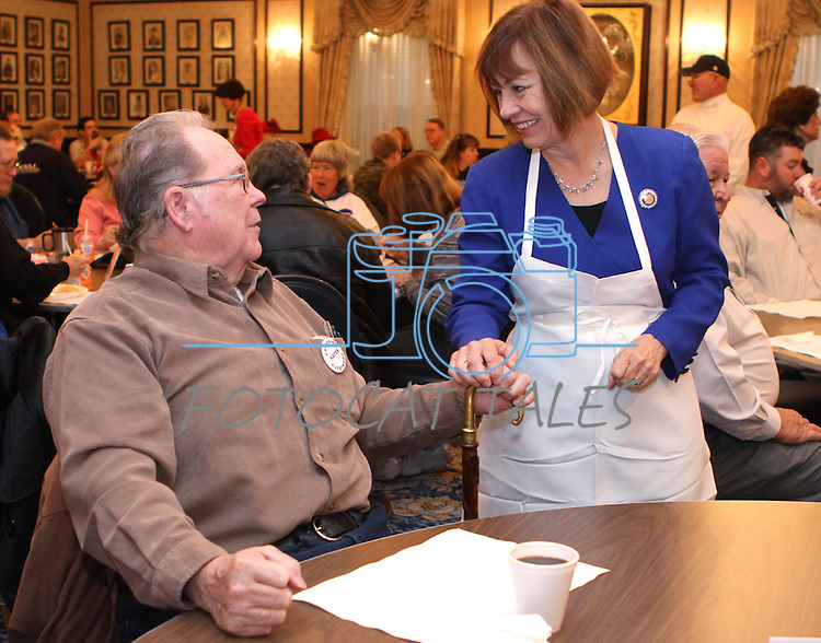 U.S. Senate candidate Sharron Angle talks with Jack Franklin during the annual Carson City Republican Women's Nevada Day Pancake Breakfast at the Governor's Mansion on Saturday morning, Oct. 30, 2010, in Carson City, Nev. .Photo by Cathleen Allison