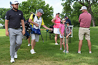 Tyrrell Hatton's (ENG) caddie gives a ball to a young fan on their way to the tee on 3 during round 2 of the 2019 Charles Schwab Challenge, Colonial Country Club, Ft. Worth, Texas,  USA. 5/24/2019.<br /> Picture: Golffile   Ken Murray<br /> <br /> All photo usage must carry mandatory copyright credit (© Golffile   Ken Murray)