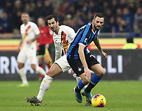 Calcio, Serie A: Inter Milano - AS Roma, Giuseppe Meazza stadium, December 6, 2019.<br /> Inter's Marcelo Brozovic (l) in action with Roma's Henrikh Mkhitaryan (r) during the Italian Serie A football match between Inter and Roma at Giuseppe Meazza (San Siro) stadium, on December 6, 2019.<br /> UPDATE IMAGES PRESS/Isabella Bonotto