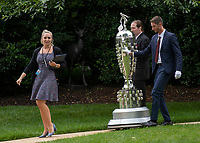 Alexandra Veletsis, left, Staff Assistant, Office of Public Liaison, Executive Office of the President, escorts two men and the Borg-WarnerTrophy to the South Lawn of the White House in Washington, DC prior to United States President Donald J. Trump greeting the 103rd Indianapolis 500 Champions: Team Penske, on Monday, June 10, 2019.  The President took some questions on trade, Mexico, and tariffs against China.<br /> CAP/MPI/RS<br /> ©RS/MPI/Capital Pictures