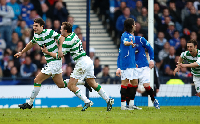 Darren O'Dea and Aiden McGeady race off to celebrate the opener for Celtic