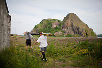 Neil Elliott and his friend carry a caber near Dumbarton. Neil competes in over 40 Highland Games and heavyweight events across the world throughout the summer.