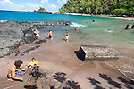Maui, Hawaii. Families enjoying a sunny, Sunday afternoon in Hana Bay, Maui.