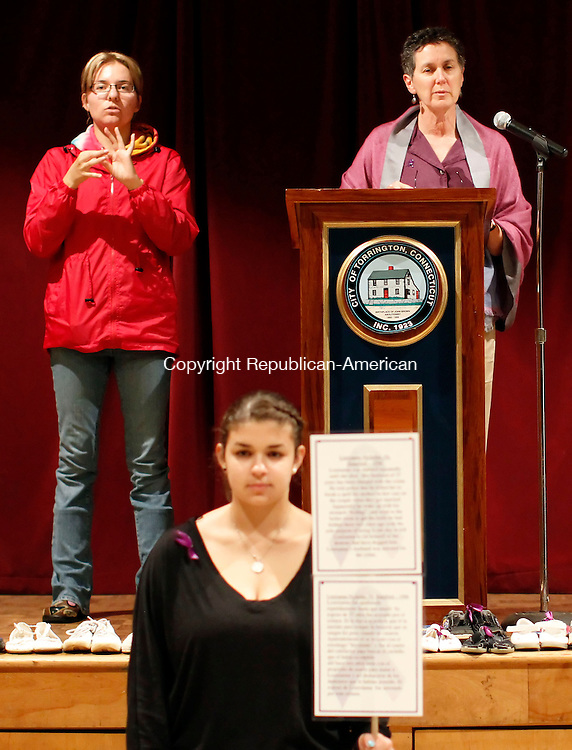 """Torrington, CT-04 October 2012-100412CM08- Barbara Spiegel, Executive Director of Susan B. Anthony Project, says a few words during their 24th annual candle light vigil inside the Coe Park auditorium Thursday night in Torrington. To the left is interpreter Tracy Follert. In the foreground is Kristina Dvilinskas,  a student at Thomaston High School and a member of the Interact Club, a Rotary Club based organization.  Dvilinskas was acting as a """"silent witness"""", which represented those who lost their lives to domestic violence.   The annual event is held to honor survivors and remembers those who have lost their lives to domestic violence.  Christopher Massa Republican-American"""