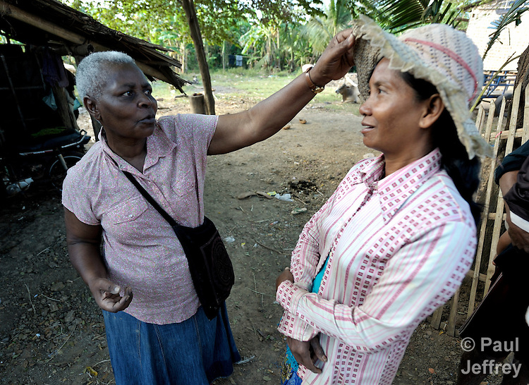 Irene Mparutsa, left, a United Methodist missionary, jokes with Sim Saroum in the Cambodian village of Talom. Mparutsa works with the Community Health and Agricultural Development program of the Methodist Mission in Cambodia.