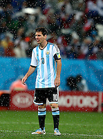 Lionel Messi of Argentina sticks his tngue out as he stands in the pouring rain