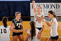 20 November 2008:  FIU outside hitter Yarimar Rosa, libero Angelina Colon (4) and other teammates celebrate the FIU 3-1 victory over South Alabama in the first round of the Sun Belt Conference Championship tournament at FIU Stadium in Miami, Florida.