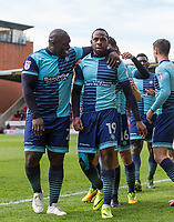 Goalkeeper Myles Weston is congratulated by Adebayo Akinfenwa of Wycombe Wanderers during the Sky Bet League 2 match between Leyton Orient and Wycombe Wanderers at the Matchroom Stadium, London, England on 1 April 2017. Photo by Andy Rowland.