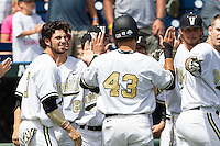 Vanderbilt Commodores shortstop Dansby Swanson (7) greets teammate Zander Wiel (43) after scoring during the NCAA College baseball World Series against the Cal State Fullerton Titans on June 15, 2015 at TD Ameritrade Park in Omaha, Nebraska. Vanderbilt beat Cal State Fullerton 4-3. (Andrew Woolley/Four Seam Images)