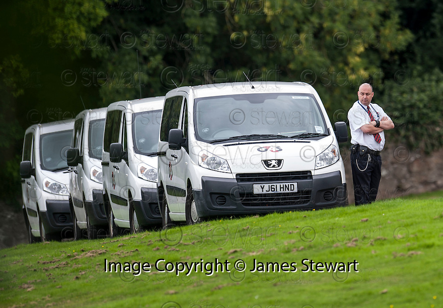 G4S vans line up at St Thomas' Cemetery, Cambusbarron, to take away some of the mourners from the funeral of former crime family matriarch Mags Haney.