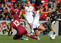 COLLEGE PARK, MD - OCTOBER 21, 2012:  Riley Barger (10) of the University of Maryland is trippeed by Kristin Grubka (13) of Florida State during an ACC women's match at Ludwig Field in College Park, MD. on October 21. Florida won 1-0.
