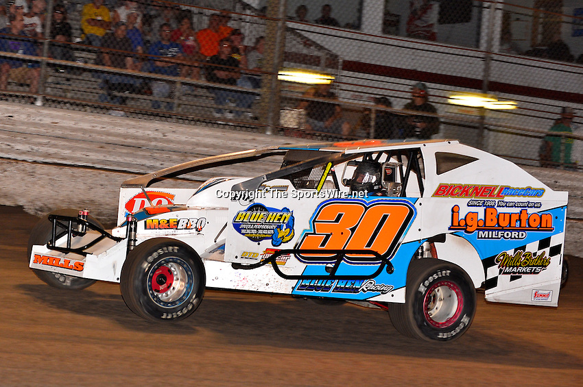 Feb 20, 2014; 6:42:29 PM;  Barberville, FL, USA;  Super DIRT car Series Big Block Modifieds presented by Summit Racing Equipment at Volusia Speedway Park.  Mandatory Credit: (thesportswire.net)