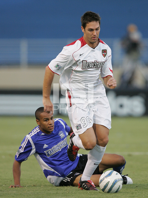 23 July 2005: Ante Razov of MetroStars dribbles the ball away from Ricardo Clark of Earthquakes during the second half of the game at Spartan Stadium in San Jose, California.  Earthquakes defeated MetroStars, 2-1.  Credit: Michael Pimentel / ISI