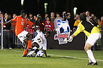 14 December 2007: Wake Forest's Ike Opara (23) defends Virginia Tech's Patrick Nyarko (GHA) (12) as Brian Edwards (r) watches. The Wake Forest University Demon Deacons defeated the Virginia Tech University Hokies 2-0 at SAS Stadium in Cary, North Carolina in a NCAA Division I Men's College Cup semifinal game.