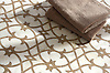 Avila, a waterjet and hand-cut mosaic shown in polished Cloud Nine and honed Lavigne, is part of the Miraflores collection by Paul Schatz for New Ravenna.