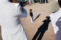 A child watches as Bolivian Navy soldiers march to mourn the day they lost their ocean to Chile in the War of the Pacific. Bolivia lost what is now northern Chile in a war over nitrates leaving Bolivia without access to the ocean.