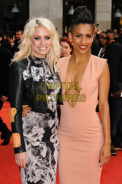 Kimberly Wyatt & Dominique Tipper.The 'Fast Girls' UK film premiere, Odeon West End cinema, Leicester Square, London, England..June 7th, 2012.half length black white print dress leather jacket pink beige plunging neckline cleavage sleeveless mohawk shaved head .CAP/CJ.©Chris Joseph/Capital Pictures.