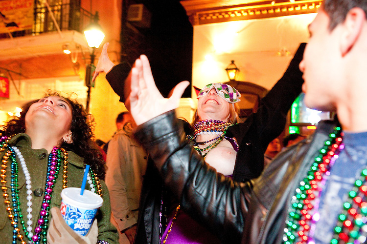 A woman exposes herself to get beads thrown from a balcony on Bourbon Street during Mardi Gras in New Orleans on February 15, 2010.