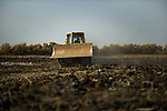 An employee drives a mechanical shovel in a field in the national park of Las Tablas de Daimiel  in Ciudad Real on November 16, 2009. The European Union launched an investigation into Spanish wetland that has turned bone dry through mismanagement of water resources  from areas where fish once swam. The EU wants the Spanish government to explain how it plans to save Las Tablas de Daimiel National Park.The park, one of Spain's few wetlands, is classified as a UNESCO biosphere site and an EU-protected area because of its birdlife. But it has been drying up for decades, largely because of wells dug by farmers on the edges of the park to tap an aquifer that feeds the wetland's lagoons. Many of the wells are illegal. Environmentalists call this case a particularly glaring example of how a natural resource can be abused. (c)Pedro ARMESTRE