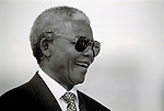 SOWETO, SOUTH AFRICA - APRIL 15: Former President Nelson Mandela of South Africa smiles as he greets people at a pre-election rally weeks before the historic democratic election on April 15, 1994 in Soweto, South Africa. The ANC freedom fighter was in prison for 27 years and released in 1990. He became President of South Africa after the first multiracial democratic elections in April 1994. Mr. Mandela retired after one term in 1999 and gave the leadership to the current president Mr. Thabo Mbeki. (Photo by Per-Anders Pettersson)