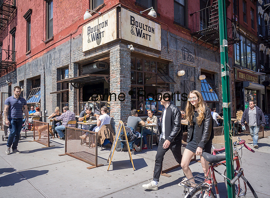 Sidewalk cafe of a bar/restaurant in the East Village neighborhood of New York on Saturday, April 16, 2016. (© Richard B. Levine)