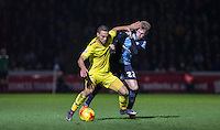 Kemar Roofe of Oxford United and Jason McCarthy of Wycombe Wanderers battle during the Sky Bet League 2 match between Wycombe Wanderers and Oxford United at Adams Park, High Wycombe, England on 19 December 2015. Photo by Andy Rowland.