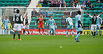 Hibs v St Johnstone...25.08.12   SPL.Chaos in the St Johnstone box as Hibs players appeal for Paul Hanlon's goal.Picture by Graeme Hart..Copyright Perthshire Picture Agency.Tel: 01738 623350  Mobile: 07990 594431