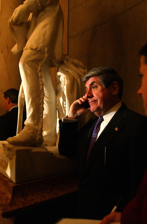 Sen. Ben Nelson, D-Neb., talks on his cell phone outside Statuary Hall, after the State of the Union address, Tuesday night.