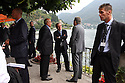 Protected by bodyguards, Roberto Maroni, Minister of Interior, speaks with some partecipants at Ambrosetti Workshop in Cernobbio, September 4, 2011. © Carlo Cerchioli