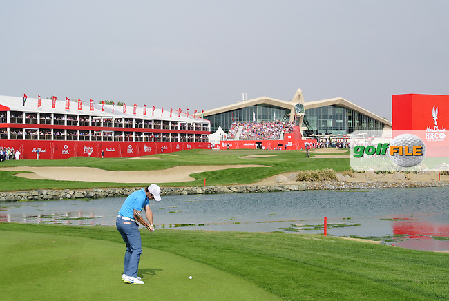 Rory McIlroy (NIR) plays his 2nd shot on the 18th hole during Sunday's Round 3 of the Abu Dhabi HSBC Golf Championship 2014 at the Abu Dhabi Gold Club, Abu Dhabi, United Arab Emirates.19th January 2014.<br /> Picture: Eoin Clarke www.golffile.ie