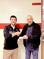 COURTESY PHOTO Michael Shaddox, counselor at McDonald County High School, accepts a $500 gift certificate to Town and Country from John Hobbs of Farm Bureau for the school's food pantry.