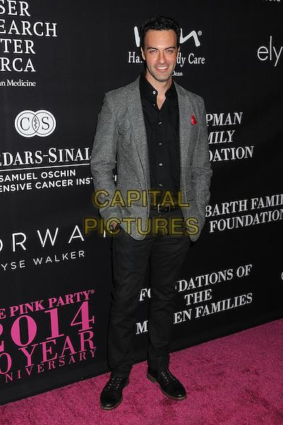 18 October 2014 - Santa Monica, California - Reid Scott. Elyse Walker's 10 Year Anniversary Pink Party held at Santa Monica Airport Hangar 8.  <br /> CAP/ADM/BP<br /> &copy;Byron Purvis/AdMedia/Capital Pictures