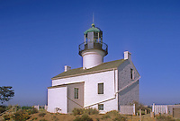 Old Point Loma Lighthouse sits on a bluff over looking the Pacific Ocean in San Diego, California