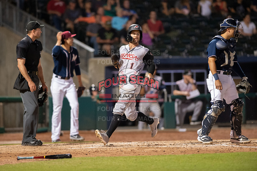 Arkansas Travelers outfielder Aaron Knapp (1) crosses the plate for a run during a Texas League game between the Northwest Arkansas Naturals and the Arkansas Travelers on May 30, 2019 at Arvest Ballpark in Springdale, Arkansas. (Jason Ivester/Four Seam Images)