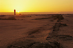 Sunrise at Amarna temple excavation, mud-brick foundation, replica temple column, .Tell el Amarna, Amenhotep IV, Akhenaten, Tutankhamun and the Golden Age of the Pharaohs, Page 76-77