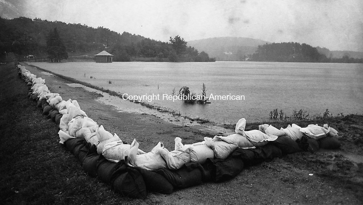 Sand bags line the rim of East Mountain Reservoir, which came within two inches of overflowing on June 5, 1982.