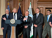 United States President Donald J. Trump signs an Energy Independence Executive Order at the Environmental Protection Agency (EPA) Headquarters in Washington, DC on Thursday, March 28, 2017.  The order reverses the Obama-era climate change policies.  From left to right: US Vice President Mike Pence; the President; EPA Administrator Scott Pruitt; US Secretary of the Interior Ryan Zinke; and US Secretary of Energy Rick Perry.<br /> Credit: Ron Sachs / Pool via CNP\