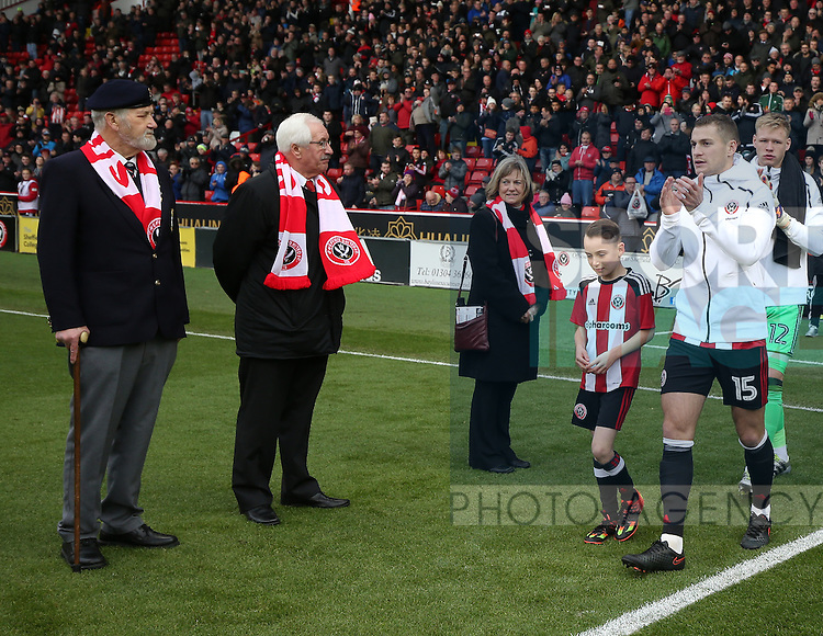Paul Coutts of Sheffield Utd leads the teams out between veterans during the Emirates FA Cup Round One match at Bramall Lane Stadium, Sheffield. Picture date: November 6th, 2016. Pic Simon Bellis/Sportimage