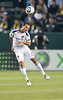 CARSON, CA – May 14, 2011: LA Galaxy midfielder Landon Donovan (10) heads the ball during the match between LA Galaxy and Sporting Kansas City at the Home Depot Center in Carson, California. Final score LA Galaxy 4, Sporting Kansas City 1.