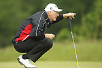 Phillip Price lines up his putt on the 2nd hole during the first round of the ISPS Handa Wales Open 2012....31.05.12.©Steve Pope