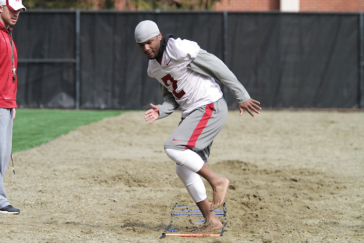 Nolan Washington works out in Leach Beach at Rogers Field during Spring football practice at Washington State University under new head football coach, Mike Leach, on March 24, 2012.