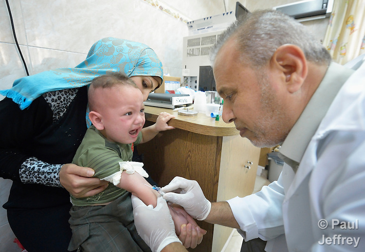 Lab technician Kamal Jad Alla takes blood from an unhappy boy in a clinic in Darraj, a neighborhood of Gaza City that was hard hit by the Israeli military during the 2014 war. The clinic is run by the Department of Service for Palestinian Refugees of the Near East Council of Churches, a member of the ACT Alliance, and funded in part by the Pontifical Mission for Palestine.