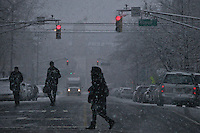 Snow falls as people cross a street in Jersey City during the season's first snow storm on December 10, 2013 in New York City Photo by Kena Betancur / VIEWpress.