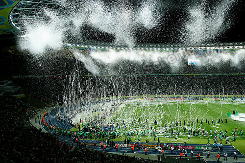 Jul 9, 2006; Berlin, GERMANY; Streamers and confetti fall from the roof of the Olympiastadion as Italy celebrate their 5-3 win over France on penalty kicks following a 1-1 draw after extra time in the final of the 2006 FIFA World Cup. Mandatory Credit: Ron Scheffler-US PRESSWIRE Copyright © Ron Scheffler